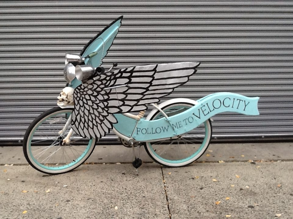 I also made this winged bike for Velocity Bikes using their shop's winged wheel and skeleton theme.