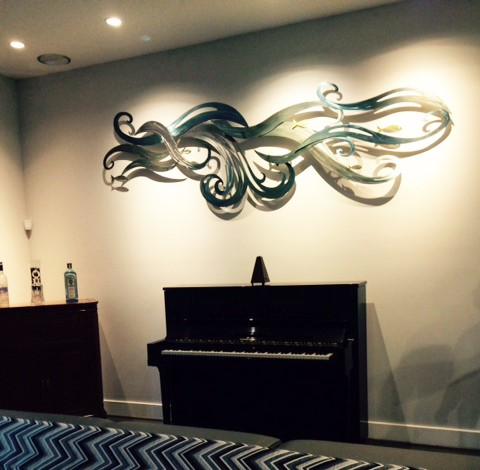 Nine foot wide custom stainless steel wall sculpture I created for a local client.