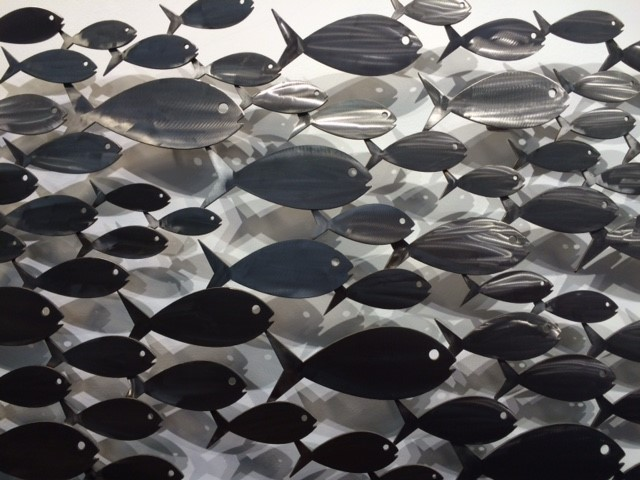 a large school of stainless steel fish for outdoor display